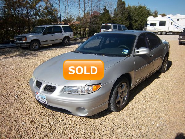 This car sold for $1200 BELOW book value!