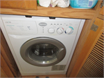 Washer dryer included in the fully outfitted 2004 Holday Rambler